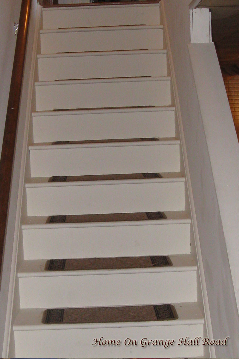 murray painted the basement stairs and added stair treads which match